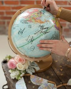 Have your guests sign a globe. | 27 School-Themed Wedding Ideas To Satisfy Your Inner Nerd