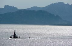 USS Newport News (SSN-750) approaching La Maddalena with Sardinia in the background.