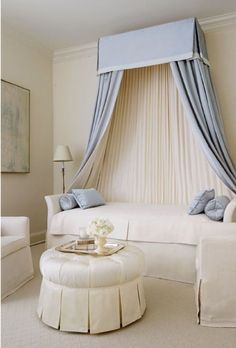 Blue and white canopy daybed