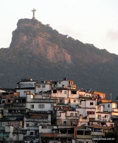 Statue of Christ the Redeemer appears to watch over a Favela