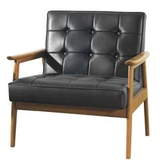 Brimming with sumptuous comfort and sleek mid-century style, this eye-catching essential is an enviable addition to your living room or den. Product: Club chair Construction Material: Solid wood and leatherette Color: Black Dimensions: H x W x 30 D