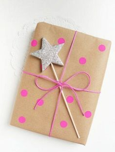 Cute and easy gift wraping using star stick, pink dots, and thread. I am going to create this idea soon! Yeay!