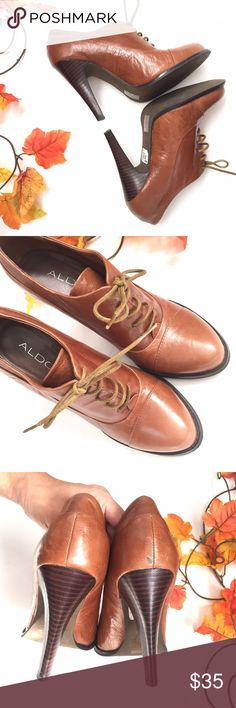 """ALDO camel leather laced up booties Camel colored leather laced up heeled booties by ALDO. In excellent gently used condition, the original price tag is still attached. There is a small scratch on the back of right shoe, see 3rd pic and soles show a small amount of wear but otherwise in great condition w clean interiors. Looks really cute with tights and a skirt or dress this fall/winter! Heels are 4.5"""", size 38. 🚫trade Aldo Shoes Ankle Boots & Booties"""