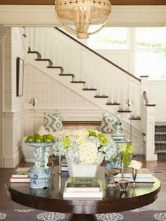 I love a central table if your entry way is large enough.