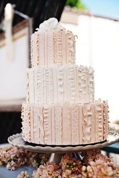 "Ribbons of ""lace"" flow down the tiers of this pretty cake"