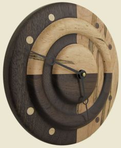 Geometric turned wood wall clock peruvian walnut and by twigsoup, $70.00