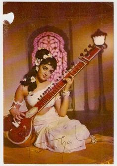 Hems Malini playing sitar