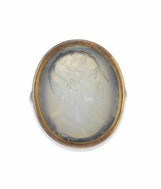 A LATE 18TH CENTURY WHITE AGATE INTAGLIO RING, BY EDWARD BURCH, RA  The oval agate panel with carved intaglio depicting Sir Isaac Newton in profile, to the plain bezel, with flared shoulders and tapering hoop, circa 1790 Signed BURCH