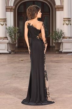 Click to buy this long black evening dress from Vero Milano - a sexy statement piece! The Yadira has transparent sides to make your waist look slimmer.