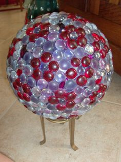 Made this with a purple bowling ball and flat marbles, use silicone II glue. be sure to bring it in over the winter.