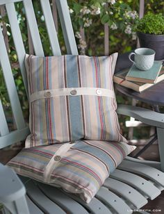 A gorgeous combination! Monaco from the Annie Sloan Fabric Collection was used to create these beautiful pillow covers along with Duck Egg Blue Chalk Paint® decorative paint by Annie Sloan for the chair | By Lia Griffith