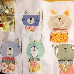 Animals in fancy stitched jumpers #stitch #illustration #fabric #buttons