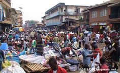 Freetown, Sierra Leone. And yes, the cars drive THROUGH all those people.
