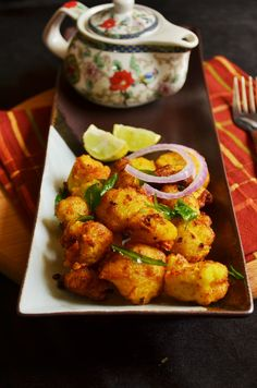Gobi 65 recipe:Here is an easy recipe for most loved fusion starter recipe with cauliflower. Gobi 65,crispy and juicy batter fried cauliflower florets adorned with onions and curry leaves,absolutely delicious starter recipe @ http://cookclickndevour.com/2014/12/gobi-65-recipe.html
