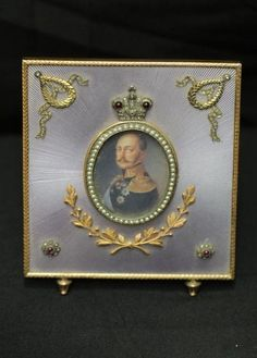 """Albert Holmstrom (1876-1925) Faberge picture frame with diamonds and precious stones believed to be ruby and pearls, back of frame marked with the Faberge mark """"AH"""" """"84"""", 4""""x4.75""""T in original Faberge box."""