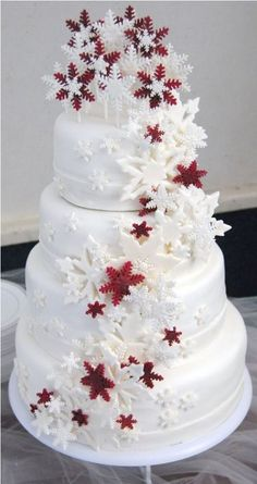 red and white winter wedding cakes with snowflakes