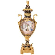 Free International Shipping - This exquisite antique Sevres style porcelain vase depicts the Emperor Napoleon in astonishing detail, mounted in elaborately ornate ormolu in the Empire style.