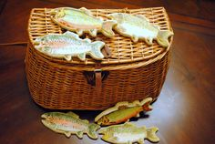 "cute groom's ""cake"" idea. Basket full of his favorite catch ... trout fish cookies ... love this!"