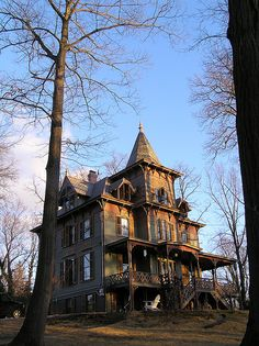 "Old house, named The Woodshed, a stick style mansion located in Sea Cliff NY on Long Island's North Shore. This grand mansion was built in 1872. The Stick Style utilizes decorative trimboards or ""Sticks"" to symbolize and emphasize the timber construction used in the framing process."