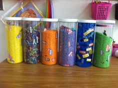 """""""Finished vocabulators at school.  I hot glued the tops on so there will be no spilling accidents at school.  The ocean one is pretty heavy and I didn't glue that top, so it's one that stays on the table and can be turned."""""""