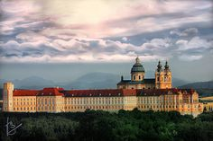 """Benektiner Abbey, """"Melk"""", a.D. 1084, Austria    Melk Abbey is positioned above the aged town of Melk on a wobbly protrusion overlooking the River Danube in the lower part of Austria joining the Wachau Valley. This abbey was founded by Leopard II, the Margrave of Austria in 1089."""