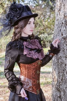 This is done well... Black top hat with the netting complimets the black Victorian styled blouse....The corset worn on the outside gives the look a lot of charachter as well as giving the figure a wonderful hourglass shape.