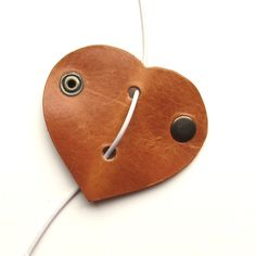Leather earbud / earphone / cable organizer in natural vegetable tanned leather handmade by RinartsAtelier