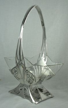 An elegant Art Deco glass basket with stylised WMF framework. 1920's
