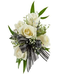 DECORATED ROSE CORSAGE, WHITE - A corsage with five white sweetheart roses and babies breath decorated with three iridescent rhinestone sprays and a black & silver bow. Designed as a wrist corsage, but can be converted to a pin on corsage with included pins. Item #4409.