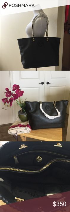 Tory Burch Marion Small E/W Tote NWT Tory Burch Marion small E/W Tote.  Cute black tote with gold hard ware.  Inside of the tote there are 2 separate compartments along with a zippered middle pocket, a back side zippered pocket and 2 open pockets for cell phone or cards.  The chain handles are still wrapped in styrofoam.  The tote comes with the dust bag.  No trades. Tory Burch Bags Totes