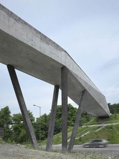 La Sallaz Footbridge by 2b architectes | This concrete footbridge spans a road in Lausanne, Switzerland, to connect a metro station with the scenic Sauvabelin Forest