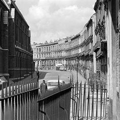 A street view along Clarendon Crescent, Paddington, houses now demolished, looking west with St Mary Magdalene's Church to left.  Photograph by John Gay - Jan 1962 - May 1964