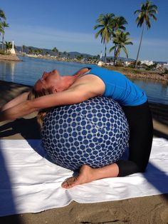 Breathe fully to come into your back bend.Stretching over my ball.. It's good and good for you!