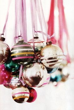 """My grandchildren's bedroom is decorated in a """"sugar plum"""" theme at Christmas. The candy covered wreath includes these types of balls."""