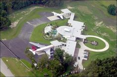 John Travolta's Florida mansion has the appearance of a mini airport from above – largely due to the private Boeing parked outside. See more of : John Travolta Celine Dion, Bruce Dickinson, Ocala Florida, Florida Home, Florida Style, Florida Girl, Eddie Murphy, George Clooney, John Travolta House