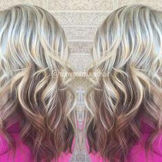 Platinum blonde highlights with redish brown underneath.