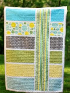 """NOW WITH LINK TO PATTERN!! Horizontal block quilt with vertical stripe detail. - Modern, simple quilt. Perfect to repurpose the out """"fancy"""" Dwell Studio crib sheets for the big boy room. - Modern Quilt Pattern"""