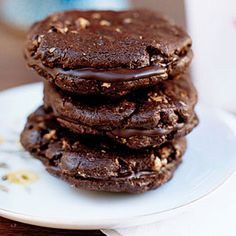 Prepare to abandon all restraint when you try one of these cookies, made with melted chocolate and chocolate chips in the batter and layered with a chocolate ganache filling.