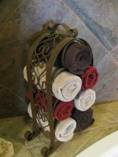 Wine Rack as Towel Rack.You could do this with taller racks and use shower towels not just hand towls. hmm great idea for apartment bathroom? Tuscan House, Bathroom Towels, Bathroom Small, Design Bathroom, Tuscan Bathroom Decor, Bathroom Ideas, Kitchen Decor, Bathtub Decor, Kitchen Towels