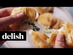 How to Make Spinach Artichoke Bombs Video - Spinach Artichoke Dip-Stuffed Crescent Rolls - Delish.com