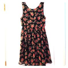 Small Black Dress with Rose Pattern Adorable Monteau black dress with light pink green yellow and blue flowered design. Has an elastic waistband so it is stretchy and can also fit a medium. Monteau Dresses