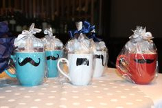 Little Man/Mustache Baby Shower: Game Prizes - mustache mugs from lovegracejoy (Etsy).  Filled with packets of hot cocoa, gourmet marshmallows and peppermint sticks.