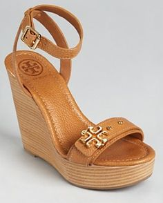 I am on a Tory Burch kick lately. Love these wedges:)