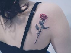Rose tattoo on the shoulder blade / upper back.
