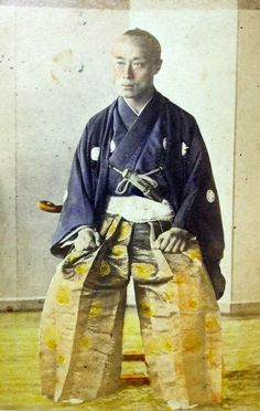 1860'S HAND TINTED PHOTO OF TOKUGAWA YOSHINOBU (AKA Stots-Bashi) BY THE PHOTOGRAPHER F.W. SUTTON; SUTTON WAS AN AMATEUR PHOTOGRAPHER WHO ESSENTIALLY LUCKED INTO A GREAT SITUATION AND HAD AN OPPORTUNITY TO PHOTOGRAPH YOSHINOBU WHILE DOCKED IN OSAKA IN 1867. HE WAS ALSO CALLED THE JAPANESE TYCOON BY WESTERNERS.