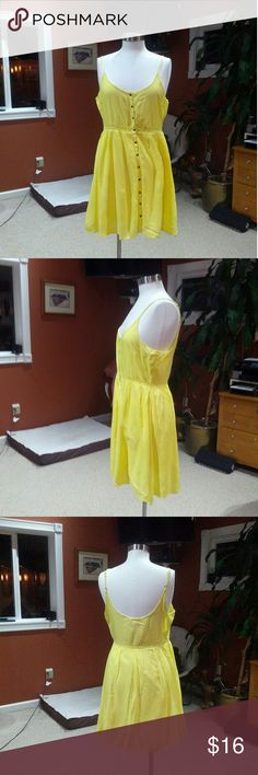 Adam Levine yellow sundress In excellent condition. Perfect summer dress. Snap buttons up the entire front. 100% rayon and fully lined. 35*  from shoulder to hemline. Adjustable straps Adam Levine Dresses Mini