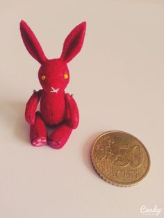 A scale 1:12 miniature toy rabbit, made of polymer clay