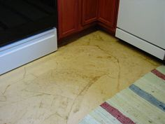 THIS is the look I want. Not too dark but enough variation to help hide the dirt of a farmhouse kitchen floor! Gotta find that paper...