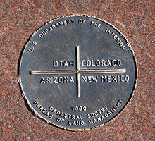 "Bucket list! Be in four places at the same time. A bronze disk reading ""U.S. Department of the Interior – Utah, Colorado, Arizona, New Mexico – 1992 – Cadastral Survey – Bureau of land Management"""