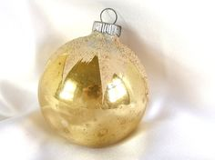 Gorgeous, large vintage Shiny Brite Christmas ornament is gold with a white snowcap. The white paint is highlighted with clear mica